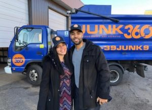 owners of Junk360 standing in front of their truck
